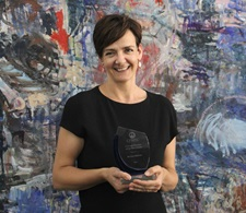 Photo of Dr Lucy Kilshaw with her award