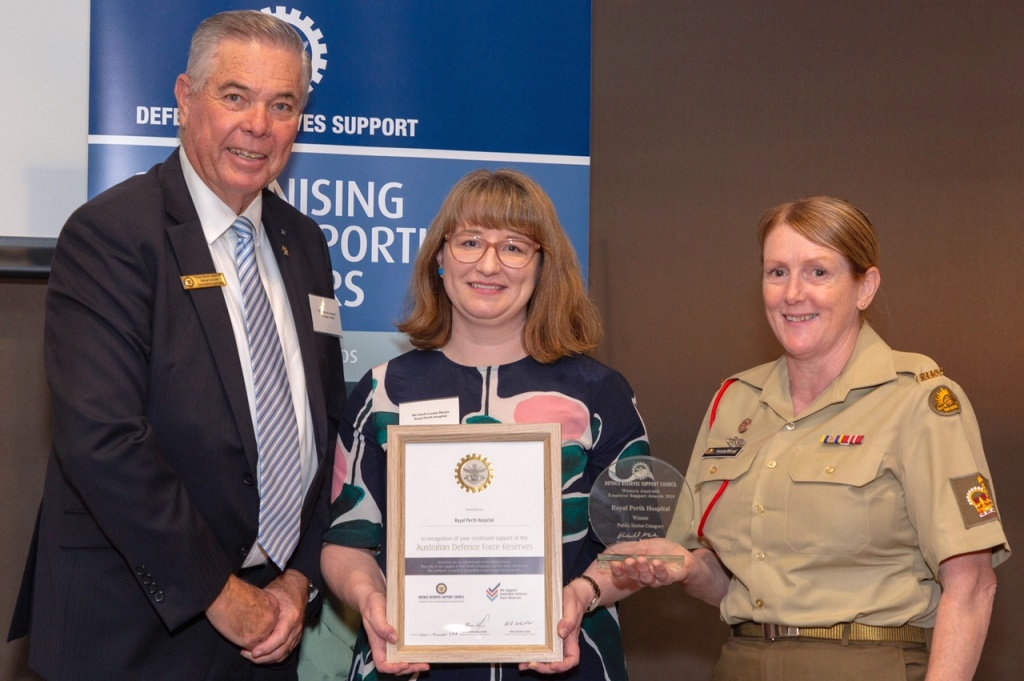 Photograph of Sarah-Louise Moyes and Pamela Mercer accepting the awards.