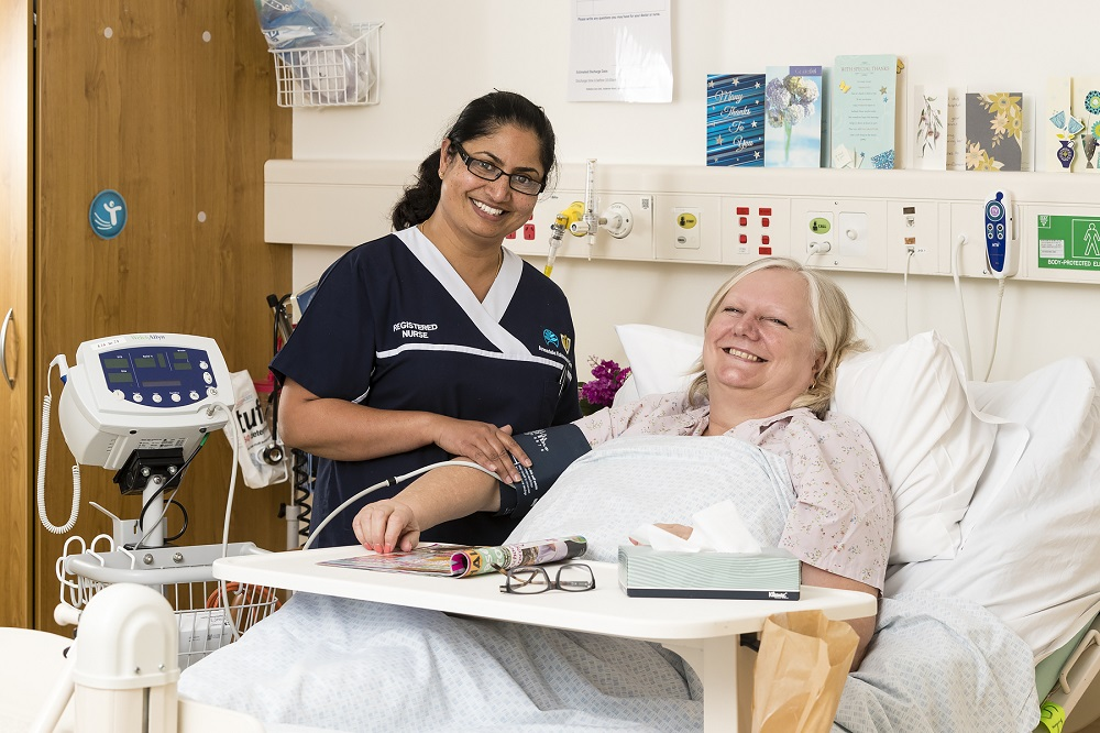 Photograph of a nurse and a patient