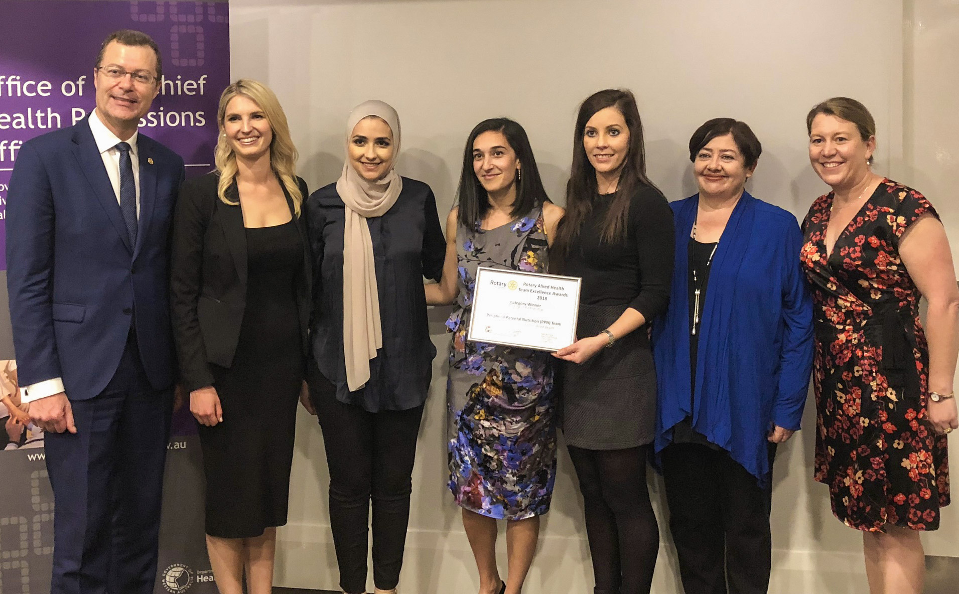 Photo of the Peripheral Parenteral Nutrition team with award